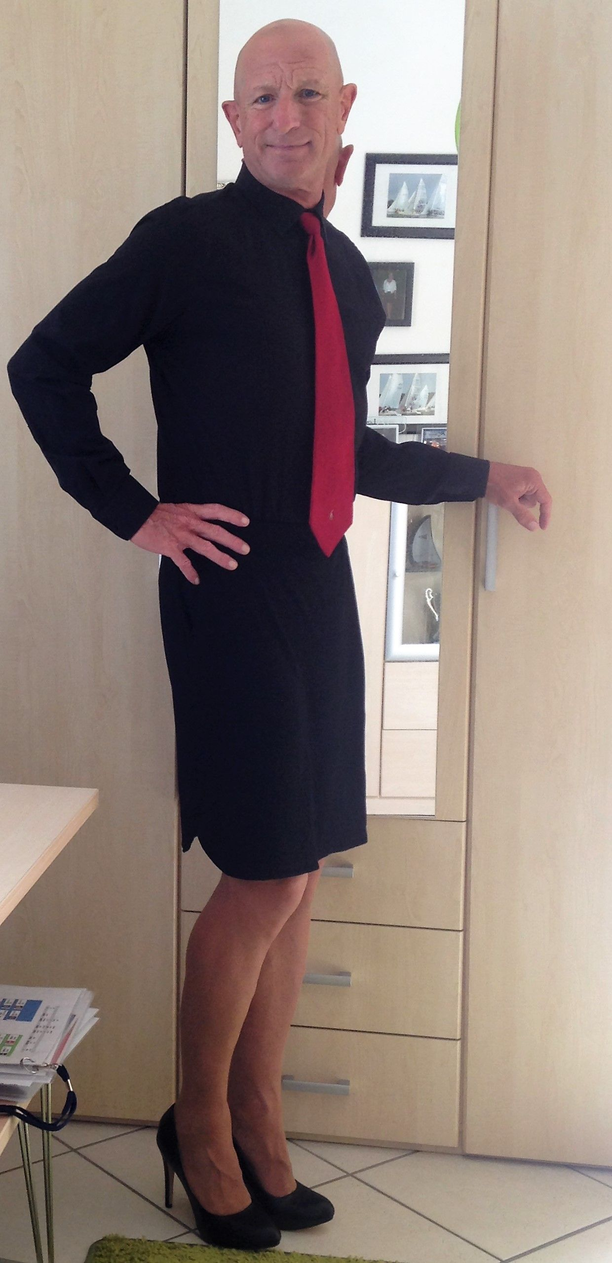 Man Wearing Black Skirt And Shirt With A Red Tie Of Course