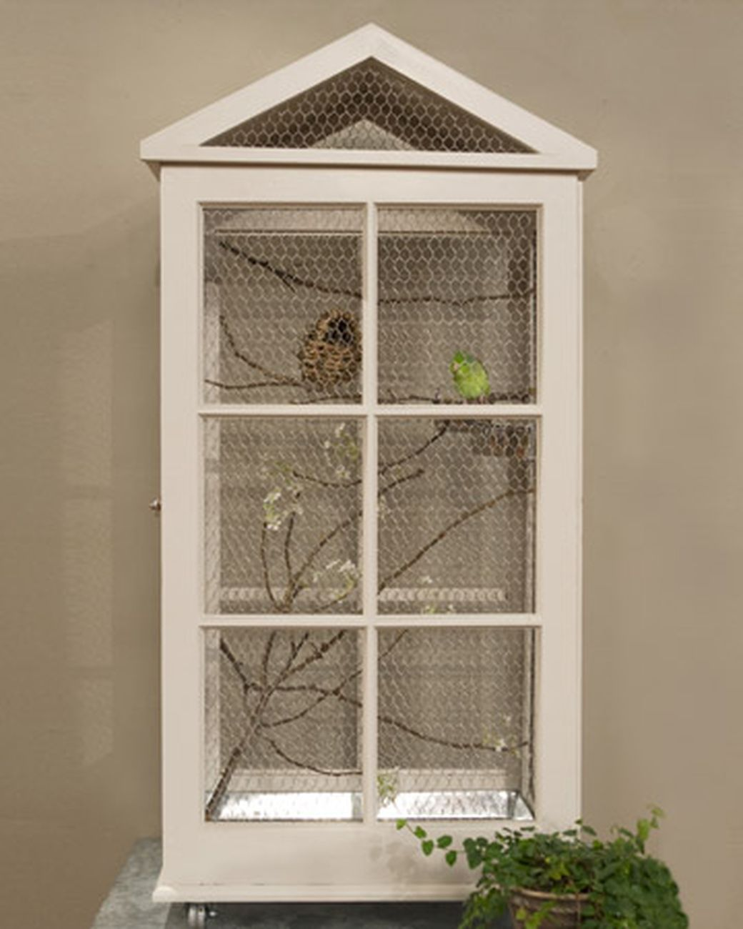 Build your favorite bird a beautiful birdcage using salvaged windows on