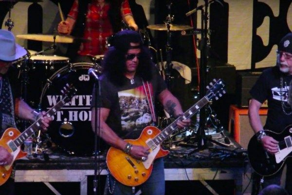 Slash wearing a Led Zeppelin Houses of the Holy t-shirt