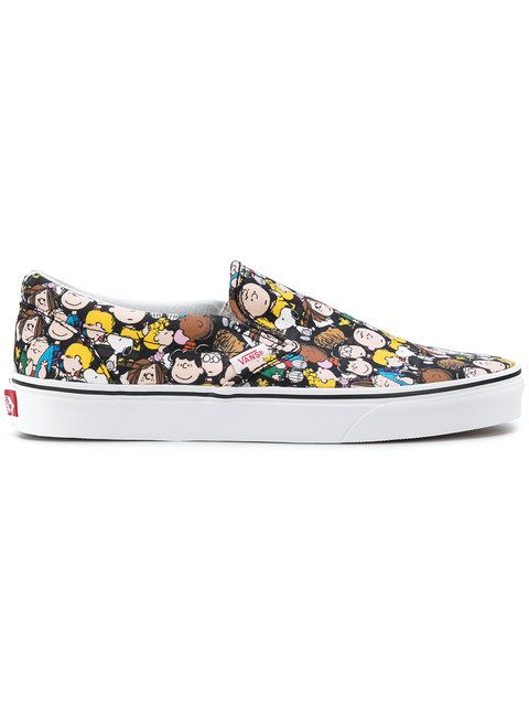 d84aed54ee Shop Vans Vans x Peanuts The Gang slip-on sneakers.