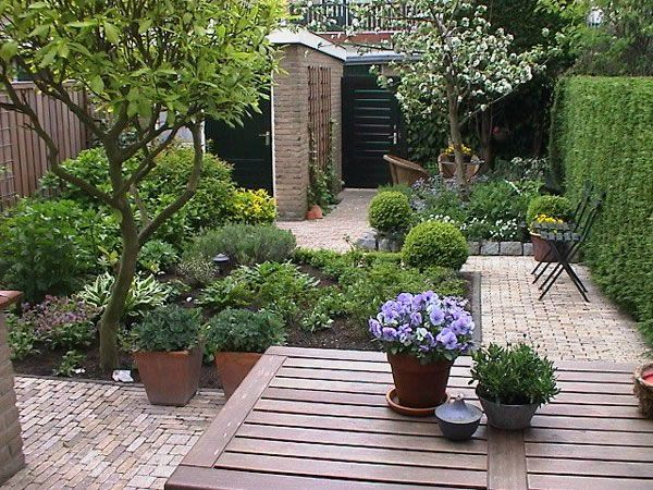 small town garden with fruit tree. Black Bedroom Furniture Sets. Home Design Ideas