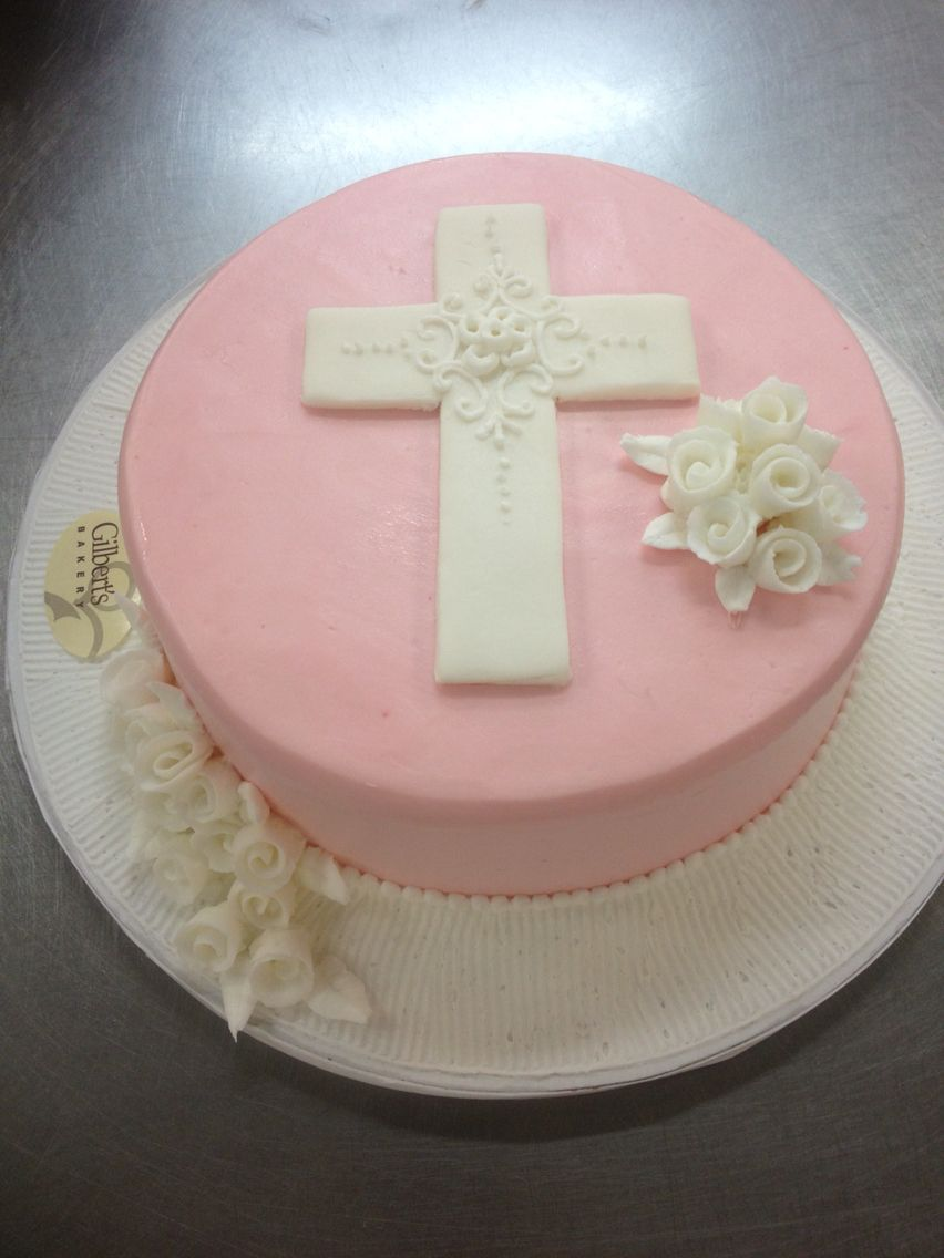 White Sugar Cross With Bunch Of White Pipped Flowers On Round Pink