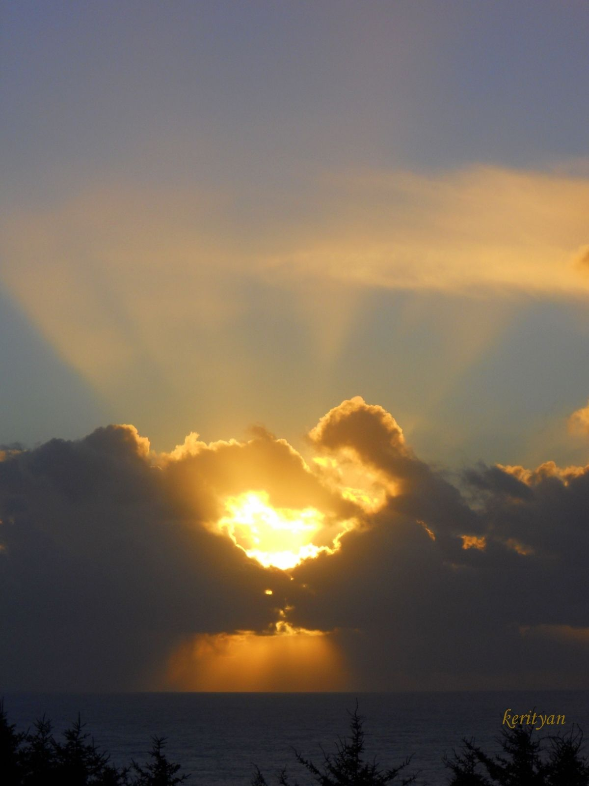 This was an Amazing hour I spent taking shots of this particular sunset. and this shot was the shot of the day! I named it, Clouds Capturing the Sun. It is NOT photoshopped! It is quite simply, God's creation.