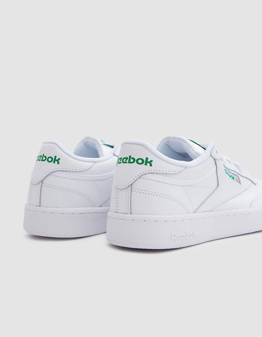 Classic low top sneaker from Reebok in White and Green. Soft leather upper.  Lace-up front with flat woven laces. Lightly padded tongue and collar. 3b934b9c3