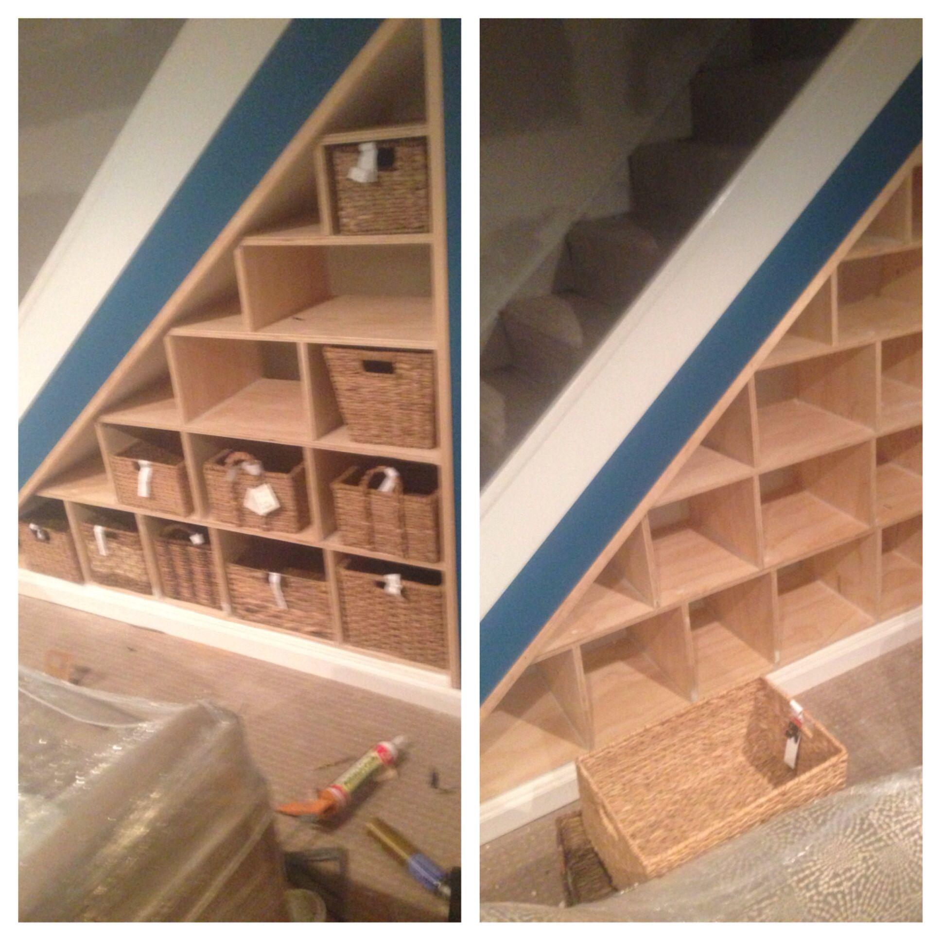 Basement storage under steps add varied size shelves for long board