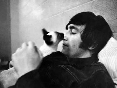John Lennon with Mimi the Siamese he owned when married to Cynthia. Named after the beloved Aunt who raised him.