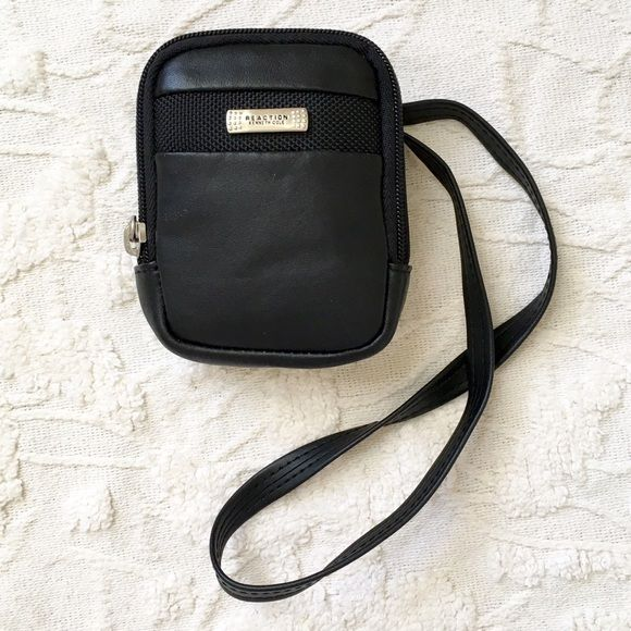 """Kenneth Cole Reaction Leather ID/Money Pouch Black leather. 4"""" x 4.5"""" x 1"""". With longer shoulder strap and velcro & snap secure belt loop to wear on belt. Wide zip opening. Red lining with slim pocket for credit card/ID. Unisex. Ideal for travel or sports.❤️ Kenneth Cole Reaction Bags Mini Bags"""