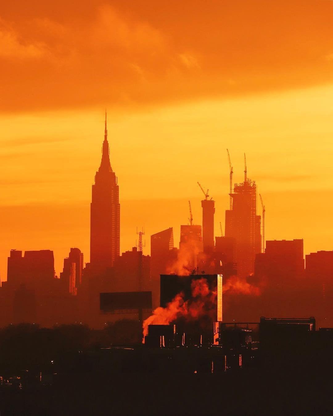 A Striking Orange Sunset Over Manhattan Phot Sunset City Photo New York
