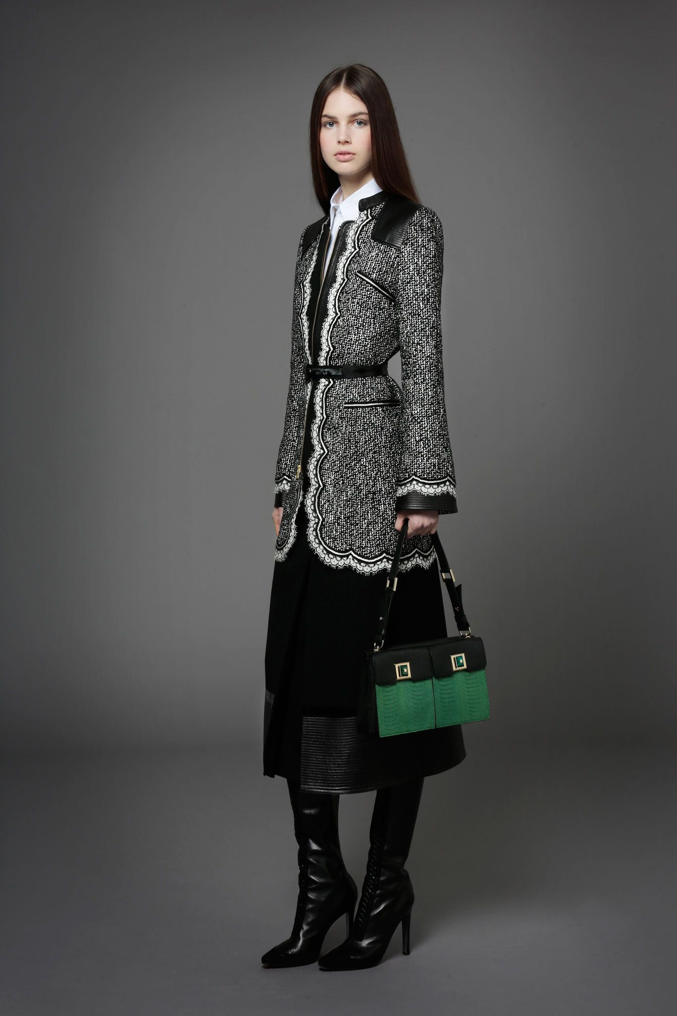 Andrew Gn Pre-Fall 2014 Fashion Show.  I like how it gives the impression of being a short coat while actually being full length.