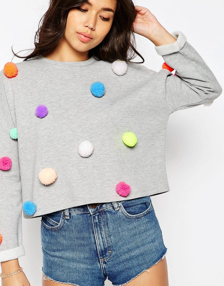 Grey sweater with colorful pom poms