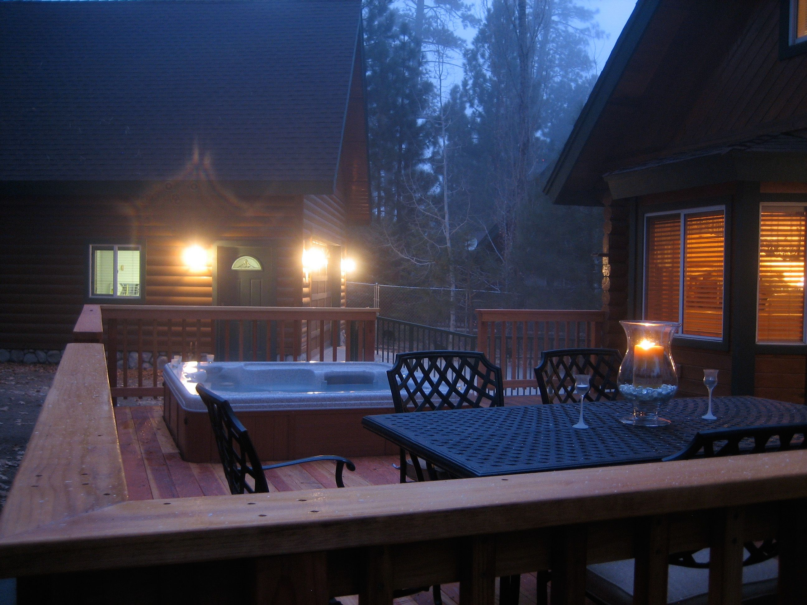 Beautiful hot tub in the back yard deck! Log cabin