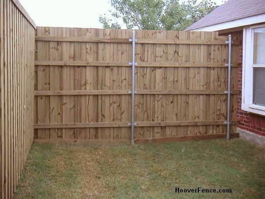 Wood Fence Panels Installed On Round Galvanized Posts