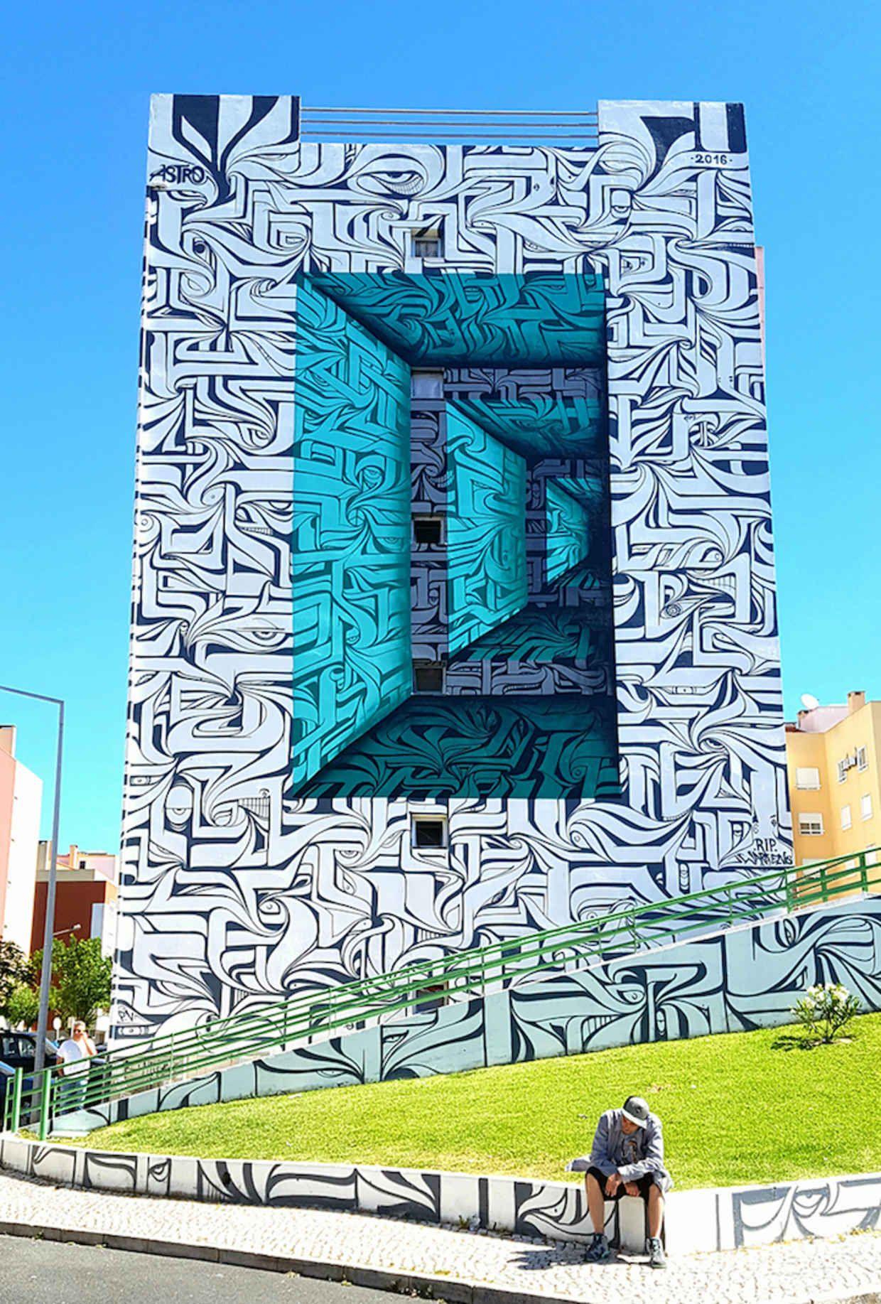 Optical illusion murals turn building facades into hypnotic