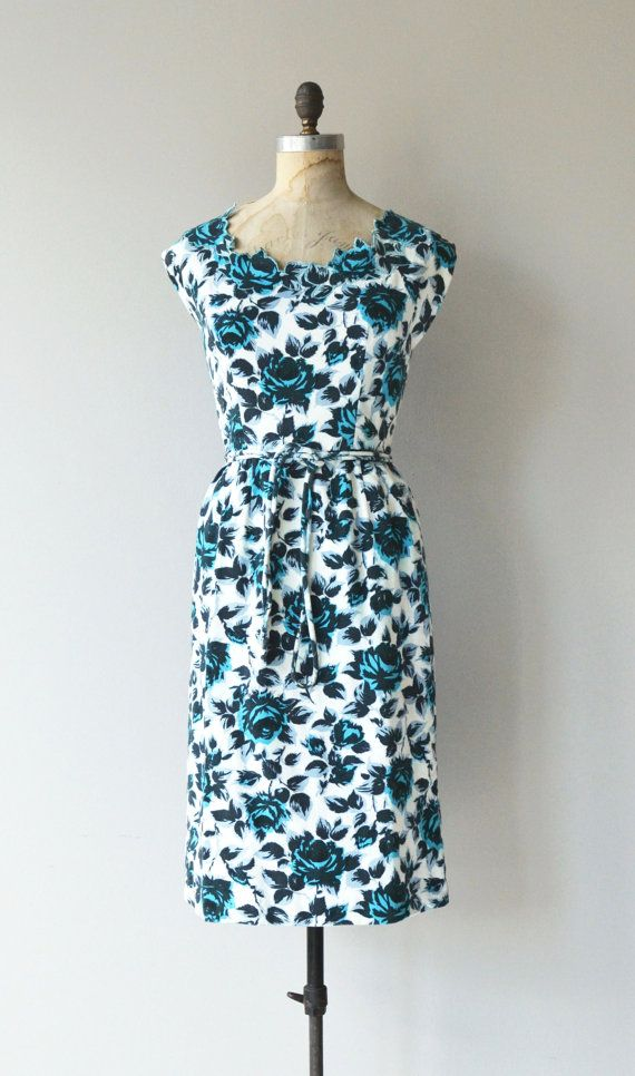 Vintage 1950s Saks Fifth Avenue cotton pique sheath dress with cutout floral neckline, cap sleeves, fitted waist with matching rope belt and metal