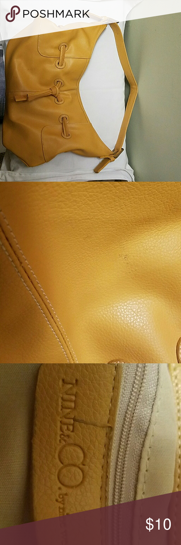 Medium-sized mustard color handbag Gently used, minor smudge that is shown in picture. On the larger size of medium Bags Shoulder Bags