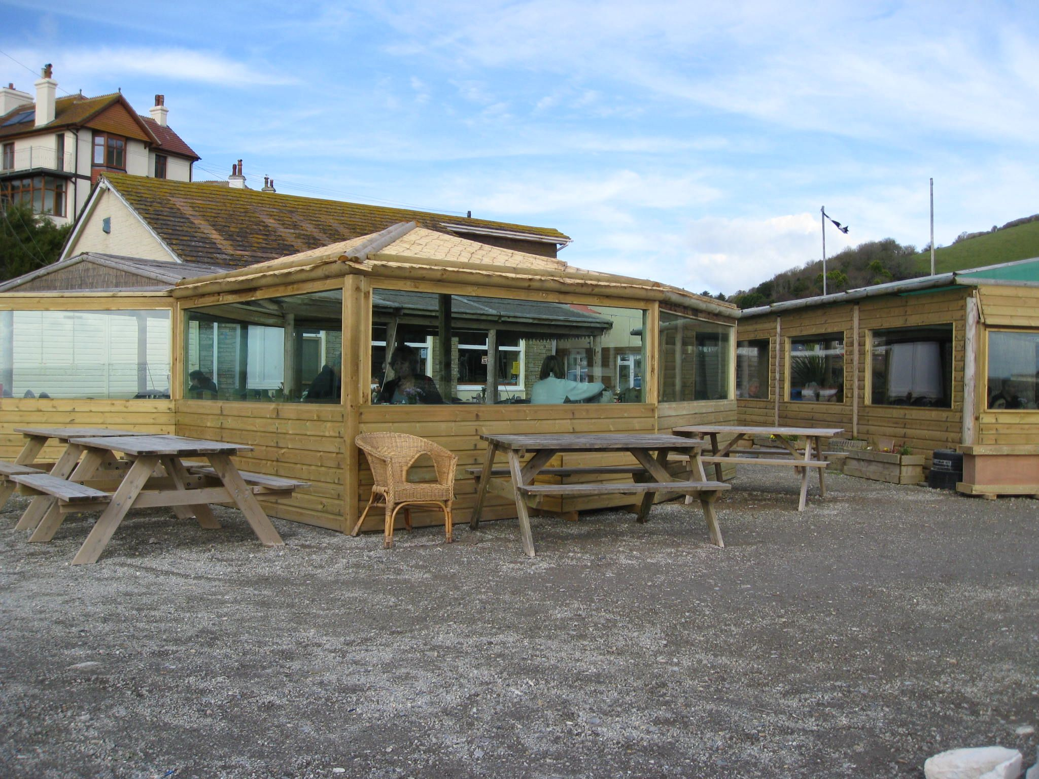 Sit in Seaton Beach Cafe and relax as you watch the sea ly a