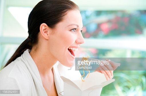 Stock Photo : Woman eating takeout