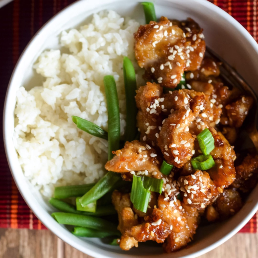 Make this amazing Gluten-Free Air Fryer Sesame Chicken in minutes, perfect to make in as an Air Fryer Recipe or Ninja Foodi Recipe! #GlutenFree #AirFryer #NinjaFoodi