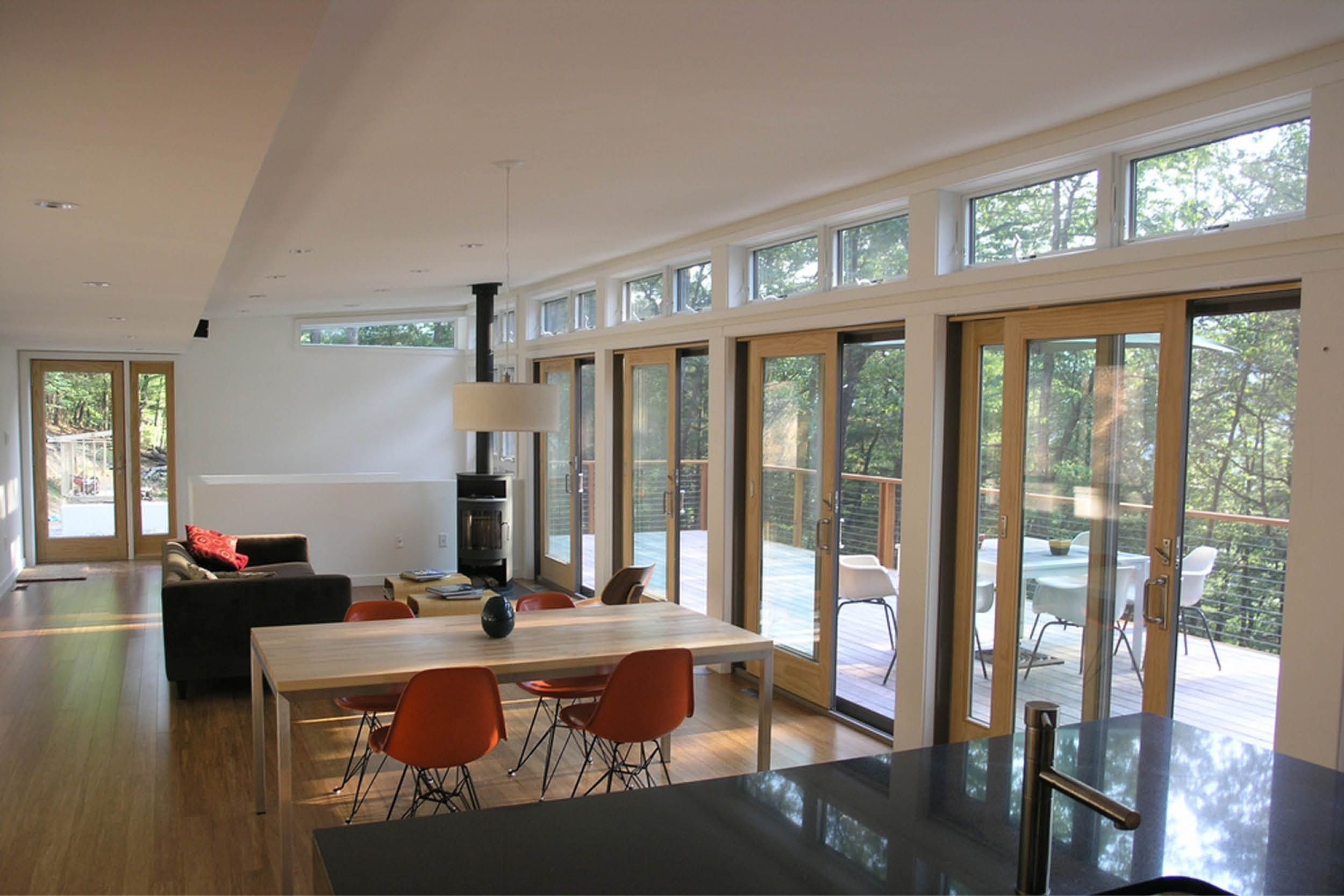 modern modular prefab house steep site living room butterfly