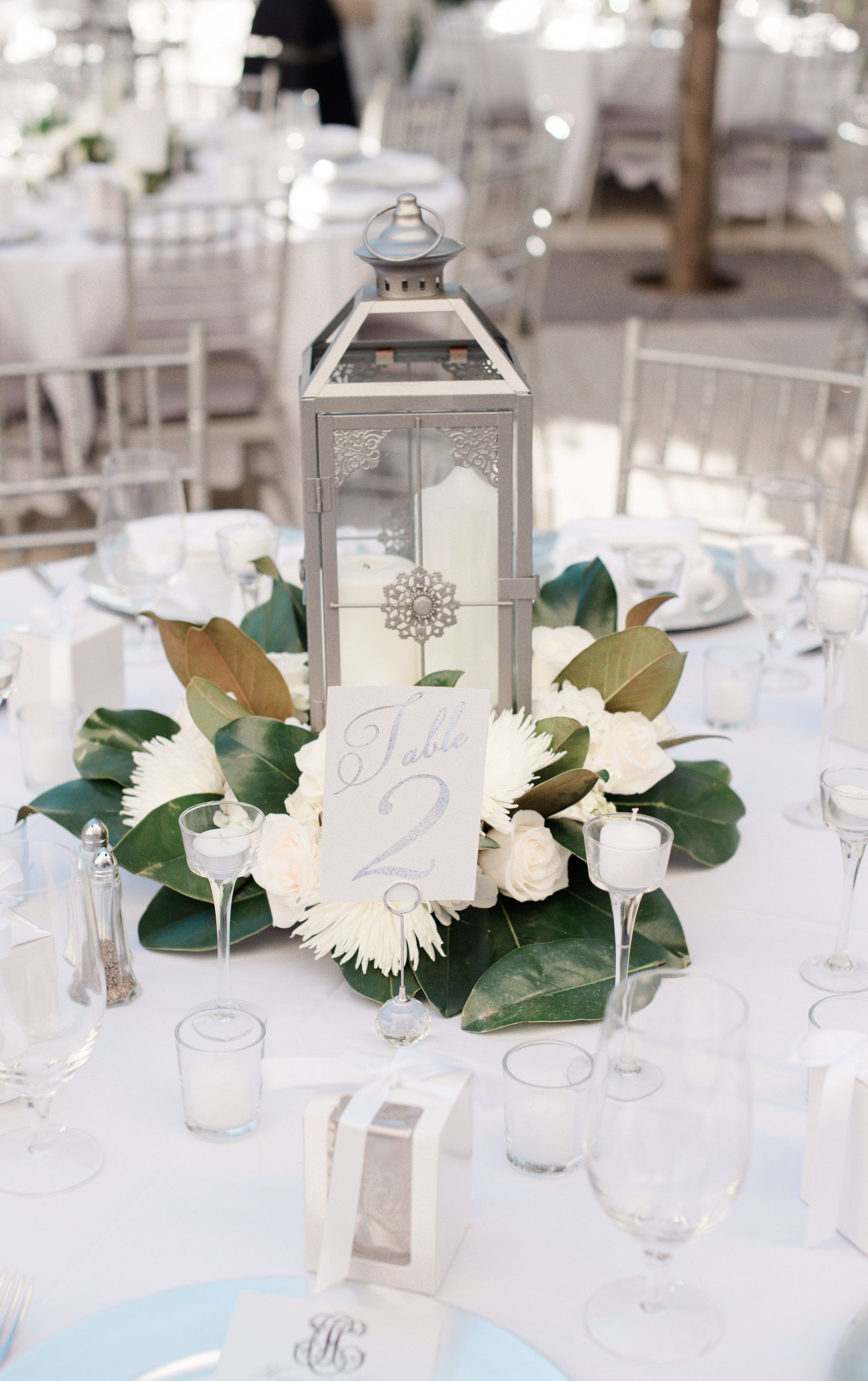 Silver lantern, magnolias, candles, table numbers, wedding ...
