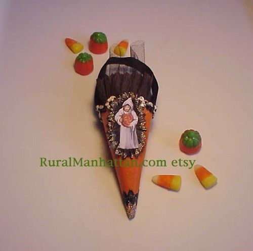 RuralManhattan on Etsy makes these lovely candy cones for feather trees and full size trees for different holidays. I purchased 2 of these for my Halloween tree last year. LOVE THEM!