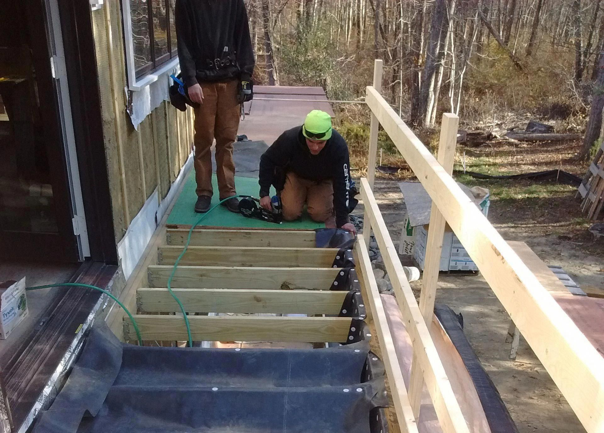 Use An Epdm Roofing Membrane And Off The Shelf Gutter Parts To Build A Cost Effective Under Deck Drainag Deck Building Cost Under Deck Drainage Building A Deck