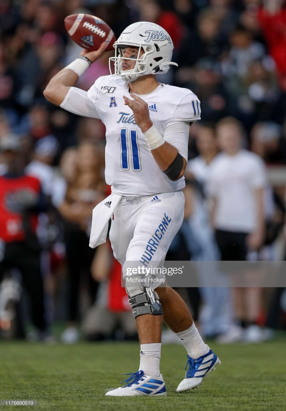Zach Smith of the Tulsa Golden Hurricane throws the ball ...