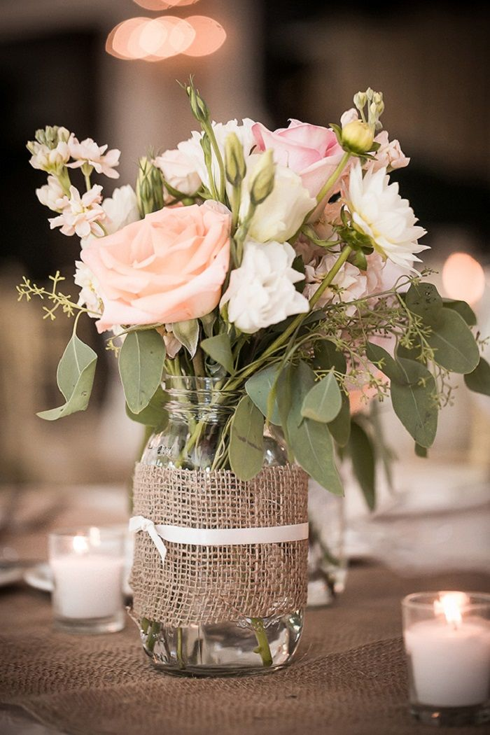 Mason jars with burlap ribbon filled in blush flowers { burlap wrapped mason jars vase } #centerpieces #masonjars #weddingcenterpieces