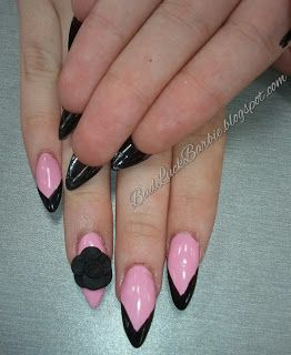 stiletto nails with a black 3d acrylic rose  underside of