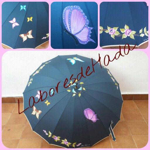 Paraguas azul  con rosas y mariposas