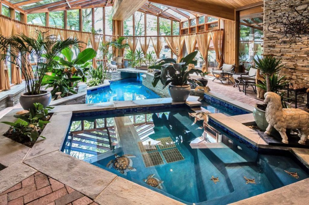 Amazing Indoor Swimming Pool With Tropical Plants