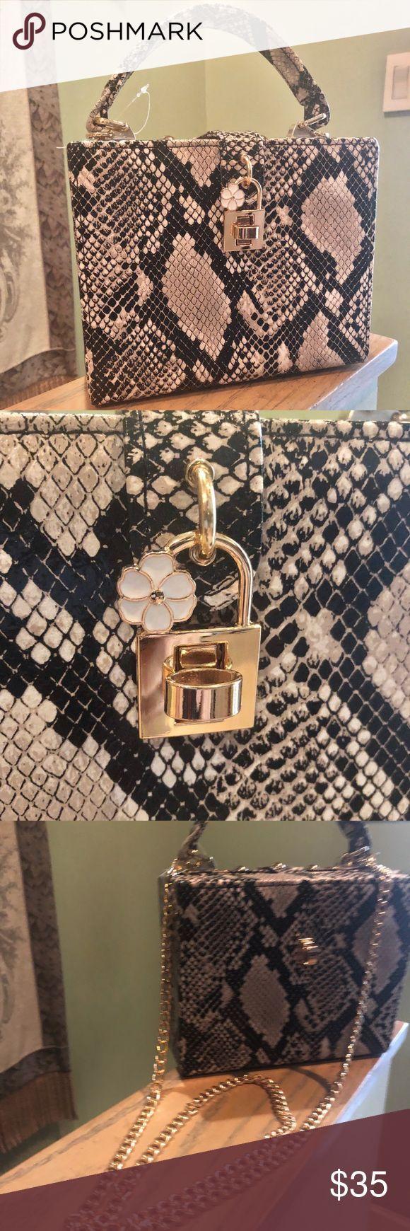 Snake print boxy bag NWOT Snake print boxy bag. Gold tone hardware with detacha#Eyes