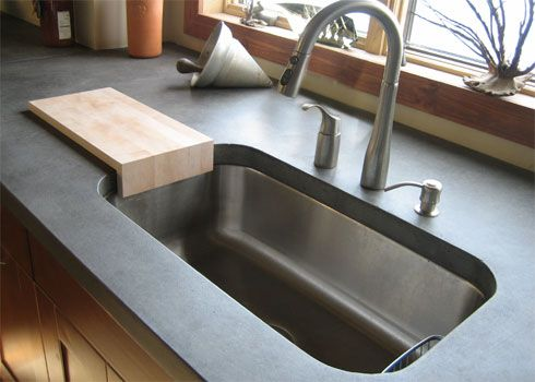 Slate Colored Concrete Kitchen Countertop With A Stainless