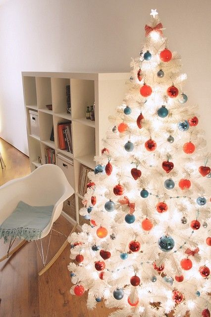 white christmas tree with coral and blue ornaments Christmas