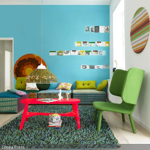 Dieses moderne Wohnzimmer erhält seinen Charme durch die - wohnzimmer farbe orange