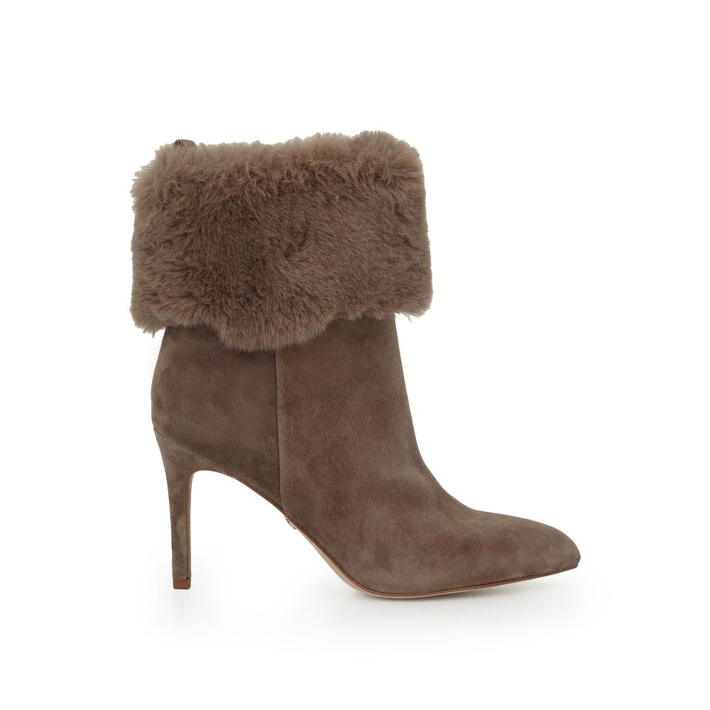 b944e25b1c630 Fabulously plush long Aspen faux fur sits at the top of this stiletto boot.  The Oleana Faux Fur Boot delivers furry elegance paired with suede or  leather.