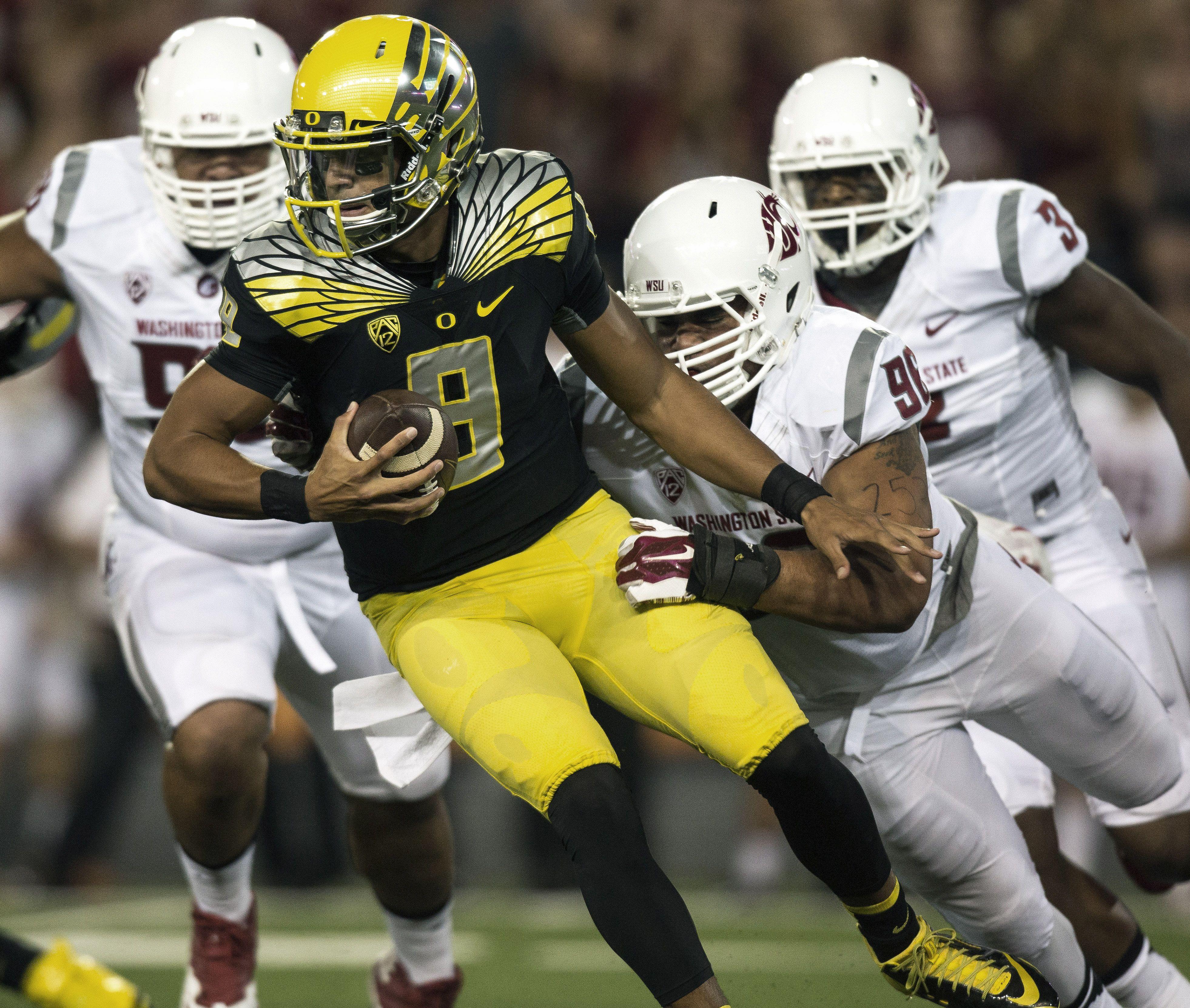 reputable site 51188 5ad06 University of Oregon Ducks yellow helmet, black jerseys in 9 ...