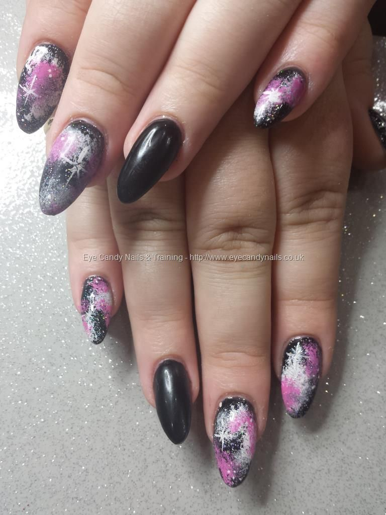 Black gel polish with pink and white freehand galaxy nail art ...