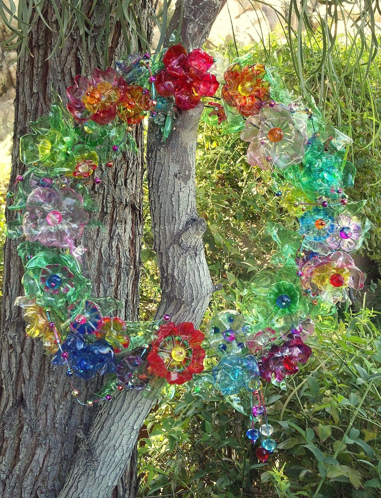 Glitterpooh discarded water bottles transformed into for Art made from plastic bottles