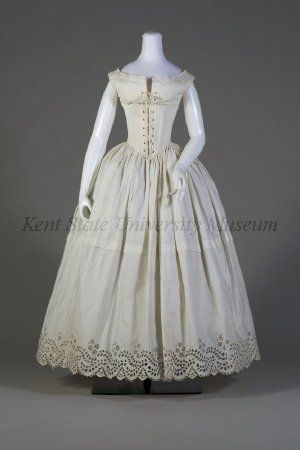 """Lingerie Set (Petticoat and Chemise): 1838-1842, American (attributed), cotton. """"Before the invention of the cage crinoline formed by steel hoops, as many as six petticoats held out the wide skirts of the late 1840s. By 1850, the expanse of skirt was so great that the waist looked small even without a heavily boned corset."""""""