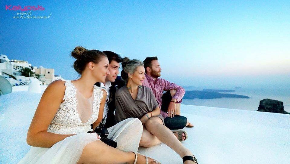 Wedding in Greece , Santorini , oia , imerovigli , sunset , after the shooting . Kalypsis events entertainment
