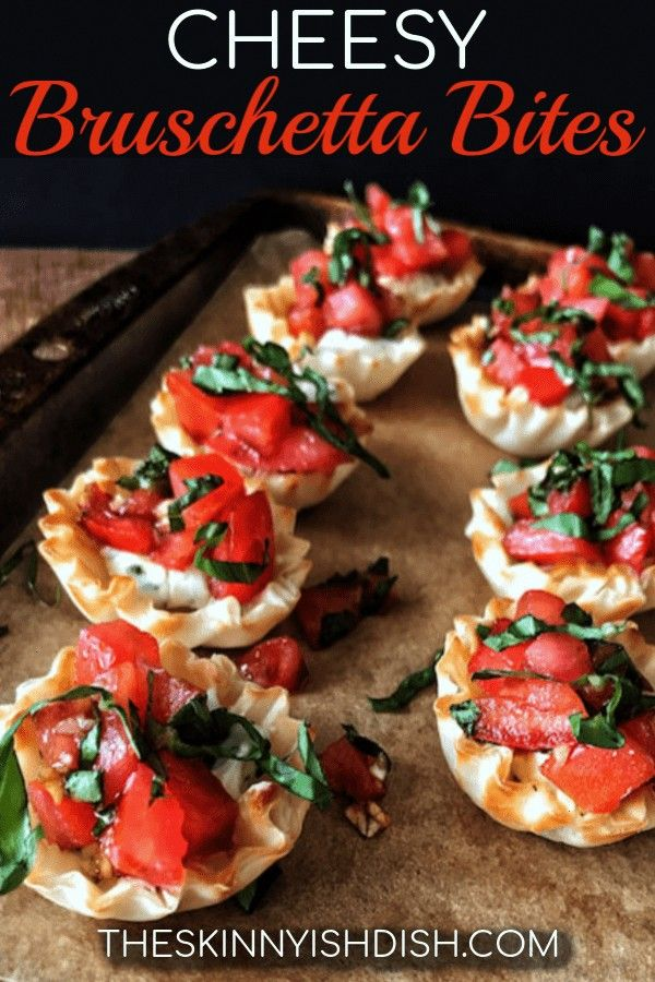your new favorite party appetizer recipe, my Cheesy Bruschetta Bites.  Mini Fillo cups filled with