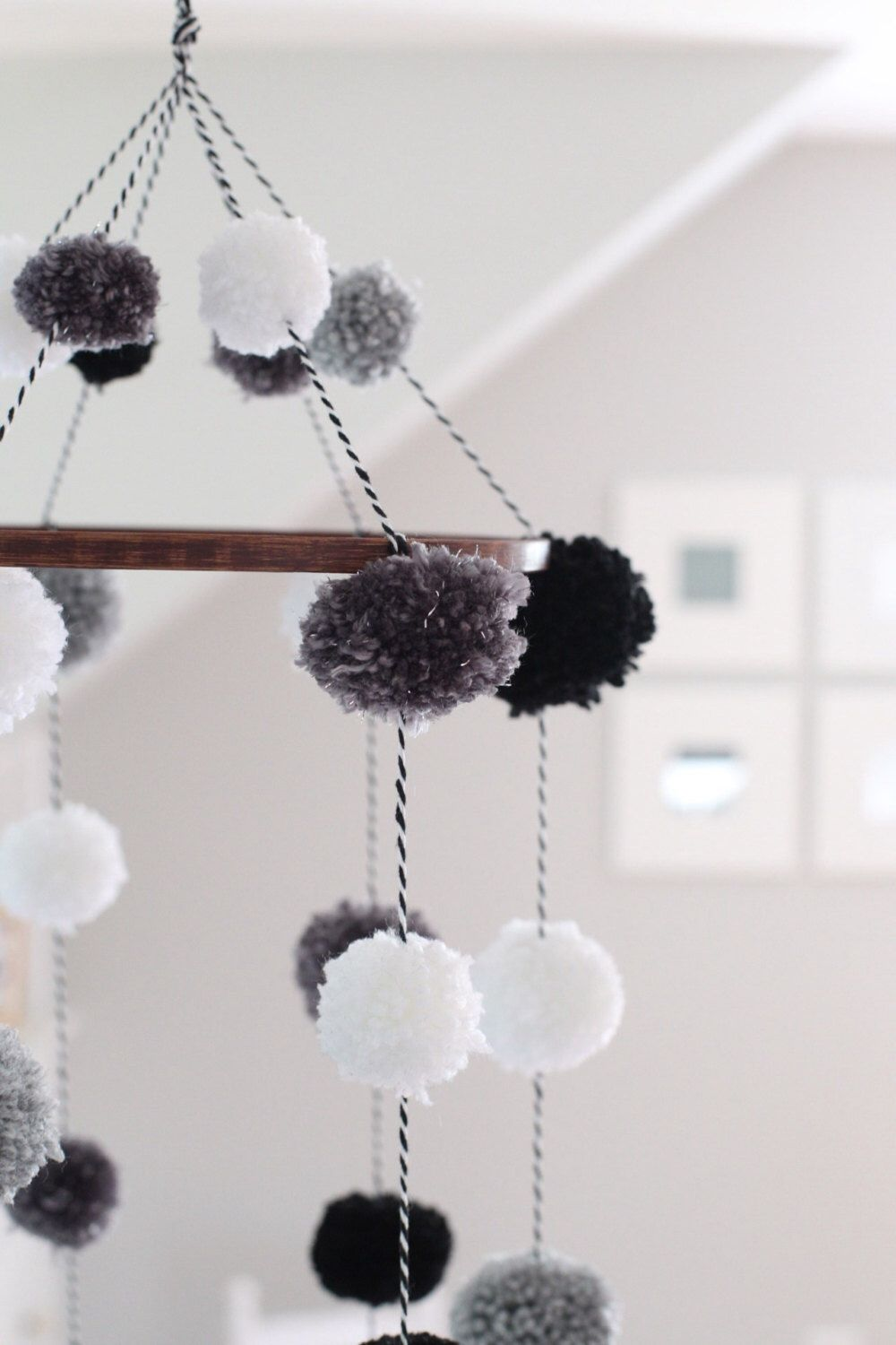 Handmade Pom Pom Mobile with Stained Wooden Hoop by Shop180 on Etsy https://www.etsy.com/listing/250628754/handmade-pom-pom-mobile-with-stained