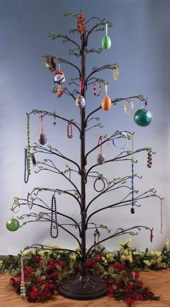 My Friend Has One Of These Trees And She Loads It Up With Lots And Lots Of Beautiful Ornam Ornament Tree Display Ornament Display