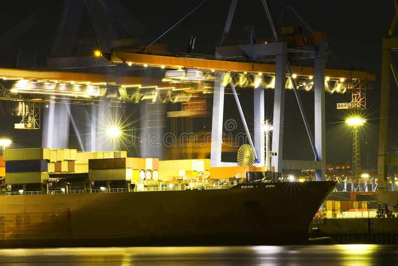Busy dock at night Large container ship in a busy dock at night
