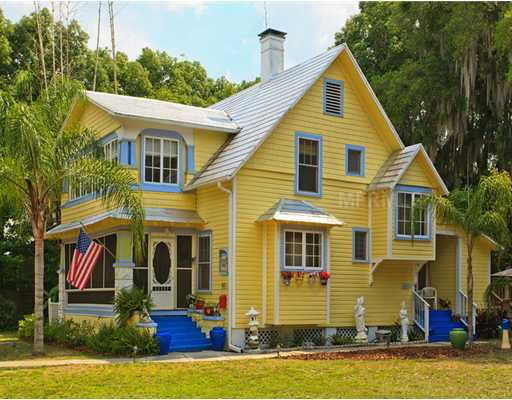 Florida yellow historic cottage yellow houses for Yellow exterior paint colors