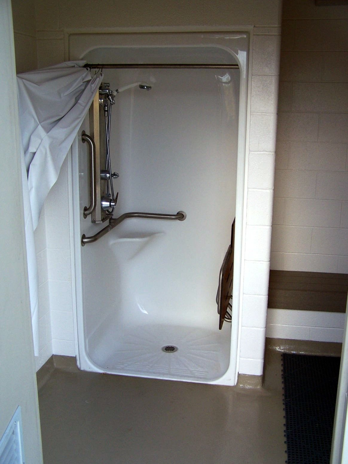 Simple, compact accessible shower stall for small spaces ...