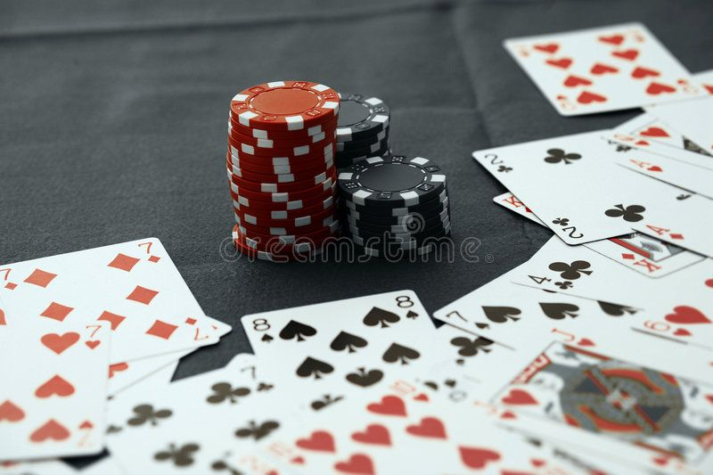 Casino chips with texas holdem poker cards spon