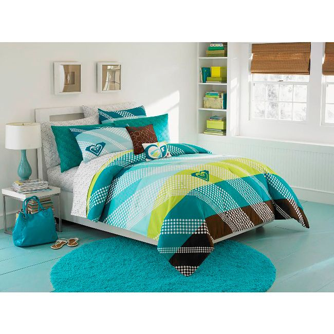 Complete any bedroom with this Summer Daze bed in a bag set. This bedding ensemble features a large stripe design in teal with white polka dots accented by the Roxy logo.