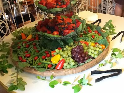 Fruit and Vegetable Displays, such as the one pictured here that we prepared on June 27, 2013 for a Life Celebration in Tallahassee, Florida serve multiple purposes. Whether positioned on its very own table or as part of a larger buffet this show stopping centerpiece from Canopy Rose Catering brings in oodles of oohs and aaahs. It is a quintessential part of many fancy soirees... Wedding Receptions, Anniversary Parties, Galas, Holiday Parties, Grand Openings....